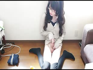 Japanese crossdresser (no mask) playing with dildo