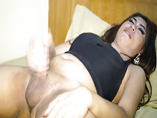 Ladyboy masturbating in a motel