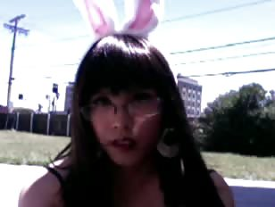Ladyboy outside and teasing with bunny ears