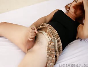 Ladyboy masturbates on HD porn set