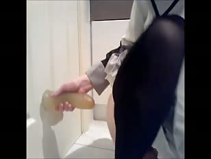 Uniform wearing babe dildo fucks a wall