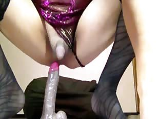 Crossdressing sissy sucks dildo