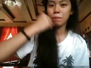 Asian ladyboy tries to eat her fist